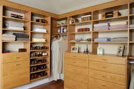 furniture brown wooden closet with graded shoe shelves and drawers also racks on the floor