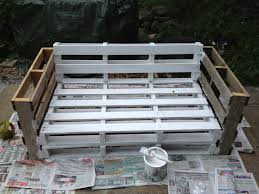 Pallet sofa. Secure all of the pieces together, paint, then add the cushions