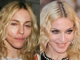madonna still looks good while walking the but take that makeup off and she is definitely showing her age