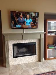60 inch samsung smart tv full motion wall mount over fireplace tv mounting over a fireplace wires concealed in wire molding
