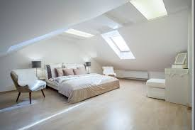 Spacious master bedroom with skylights
