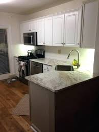 white laminate countertops turning yellow where to companies black and wood