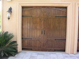 spanish custom wood door with clavos mediterranean shed