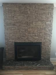 modernization my fireplace without replacing the insert should i spray paint the bricks a certain color or is it possible to somehow tile over them