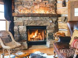 stone fireplaces with wood mantels fireplace stone fireplaces mantels wood beams glowing