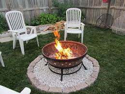 Simple Use The Brazier We Have And Just Pebble Under It So It Won T Kill The Grass Fire Pit On Grass Outdoor Fire Pit Area Fire Pit Landscaping