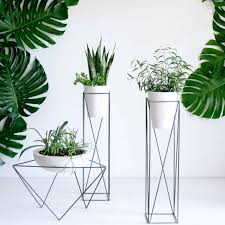 Plant stands are the great decorative feature. They elevate the plants to a  higher label. Metal, plastic or wooden, choose plant stands according to  your ...
