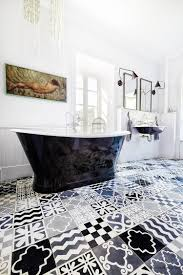 black and white bathroom with a patchwork of patterned tiles design carocim