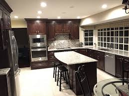 giallo ornamental light granite countertop with cherry wood cabinet