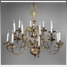 early 20th c 16 light brass flemish chandelier with double eagle