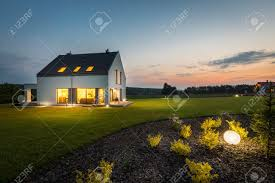 view modern house lights. Beautiful Lights Photo Of Modern House With Outdoor Lighting At Night External View Stock   Intended View Modern House Lights S