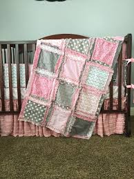 a little ruffle crib skirt in pink paired with a pink flannel chevron sheet