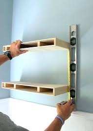 how to install wall shelves how to install shelves measuring for placement of a second floating shelf in a floating shelves how to install shelves how to