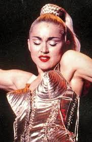 Image result for madonna the pop star with cone breasts on stage