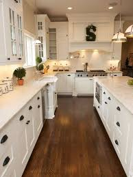 white kitchen, shaker cabinets, hardwood floor, black pulls