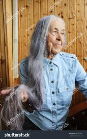 Royalty Free Old Woman With Long Gray Hair 572854354 Stock Photo