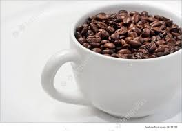 Experience pure clean energy and a smooth taste. Picture Of White Coffee Mug Filled With Whole Roasted Beans