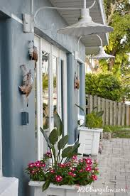 diy tutorial to hang outdoor wall art without nails or tools on stucco siding or