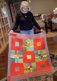 Quilts donated by Iowa City group provide comfort to those in need ... & ... Kathy Becker shows one of the quilts made by members of the service  committee of the Adamdwight.com