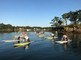 experience our paddle board yoga pilates cles on the new hshire seacoast feel your surroundings hear the sounds of the sea and let your body move