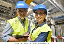 Portrait Smiling Industrial Engineers Standing Recycling Stock Photo