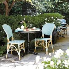 lovely woven bistro chairs are a perfect match for glossy black iron tables are we dining in paris outdoor bistro chairs
