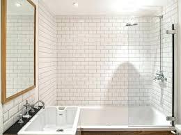 white subway tile shower with pebble floor bathroom ideas