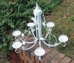 chandelier captivating chandelier candle pillar candle chandelier grass green light hinging stone outdoor amusing