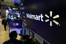 Walmart revises leave policy in face of virus; worker tests