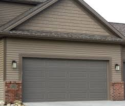 brown garage doors with windows. Bronze Garage Door In Tan Siding And Brown Trim With Red Brick Doors Windows