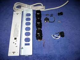 untitled document above is the inside of the power strip of parts and below is pictured all the parts from the disassembled power strip