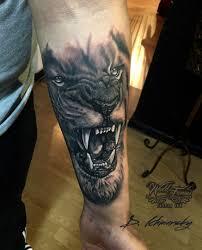 фото тату лев в стиле реализм от мастера дмитрий хмарский