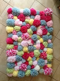 DIY POM POM rug...so easy even my husband helped!