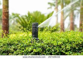 garden irrigation system. Sprinkler In Park ,Garden Irrigation System Watering Lawn Garden