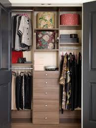 organized bedroom closet with wood shelves and drawers