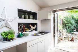 white modern kitchen with french doors real homes