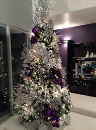 The snowflakes complement well with the other ornaments. The designer tie  the purple christmas balls together and hang in the Christmas tree, making  it look ...