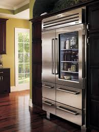 french kitchen design interior decorated with large glass door refrigerator design and wooden flooring decoration ideas