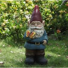 gnome holding erfly statue