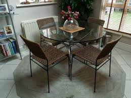 calligaris round glass table and 4 wicker chairs