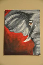 i love the colour in this painting and how you can only see half of the elephant for me it make this elephant look dangerous