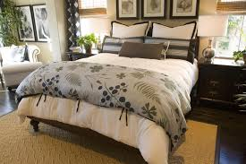 dark wood furniture decorating. nature focused blanket in this cozy bedroom complements the plant life surrounding dark wood furniture and decorating o