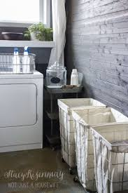 Love the wall and the wheeled laundry hampers. My vintage industrial laundry  room got organized!