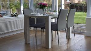 white high gloss extending dining table and chairs uk