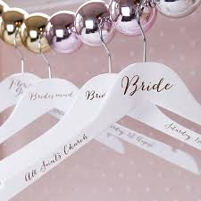 engraved wedding hanger by clouds and curs