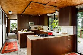 appealing kitchen with mid century modern and track lighting plus kitchen island also tile flooring