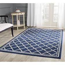 safavieh amherst collection navy and beige area rug this is a traditional moroccan trellis and includes a border it s soft and luxurious