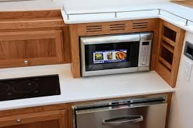 microwave moved to countertop level for easier access silverware drawer in top drawer where microwave used to be