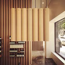 cardboard tube furniture. A Custom Light Fixture, Also Made From Cardboard Tubes, Hangs Above The Counter At Back Of Store To Ensure That Even Lighting Is In Keeping With Tube Furniture