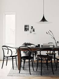 black thonet style chairs with wood table